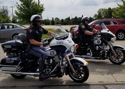 Police officers riding police motorcycles