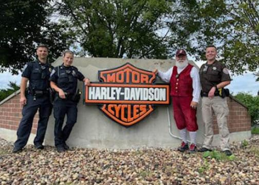 Police officers and santa at event