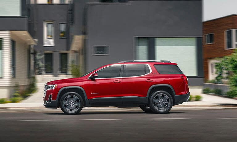 2021 GMC Acadia in red exterior parked side view