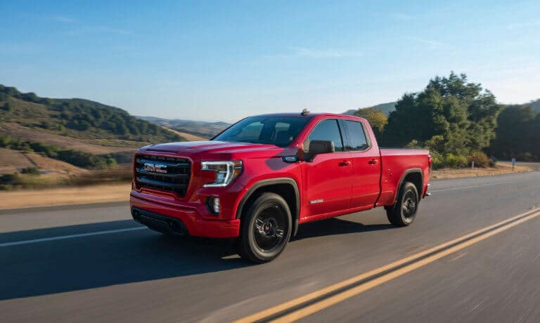 2021 GMC Sierra 1500 in red exterior pick up truck driving