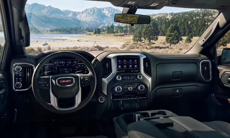 GMC Sierra 1500 front row with a view of trees and mountains