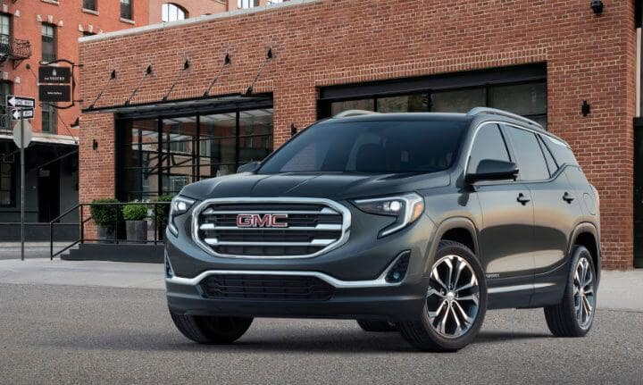 GMC Terrain parked by building