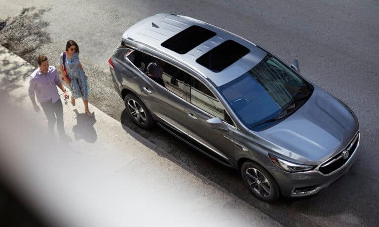 2021 Buick ENclave exterior parked beside couple walking by