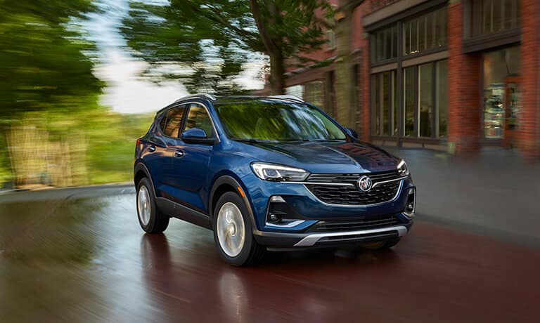 2021 Buick Encore GX exterior driving in town with red road