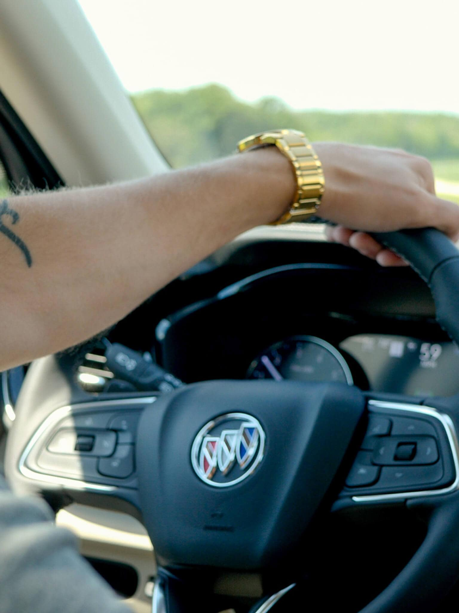 Man steering a Buick Envision from Buick GMC of Rochester