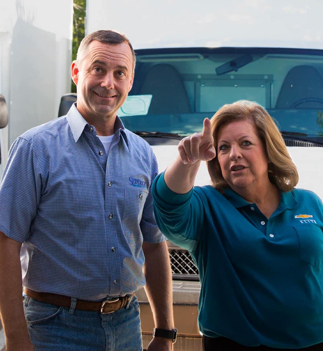 Man and woman at car dealership