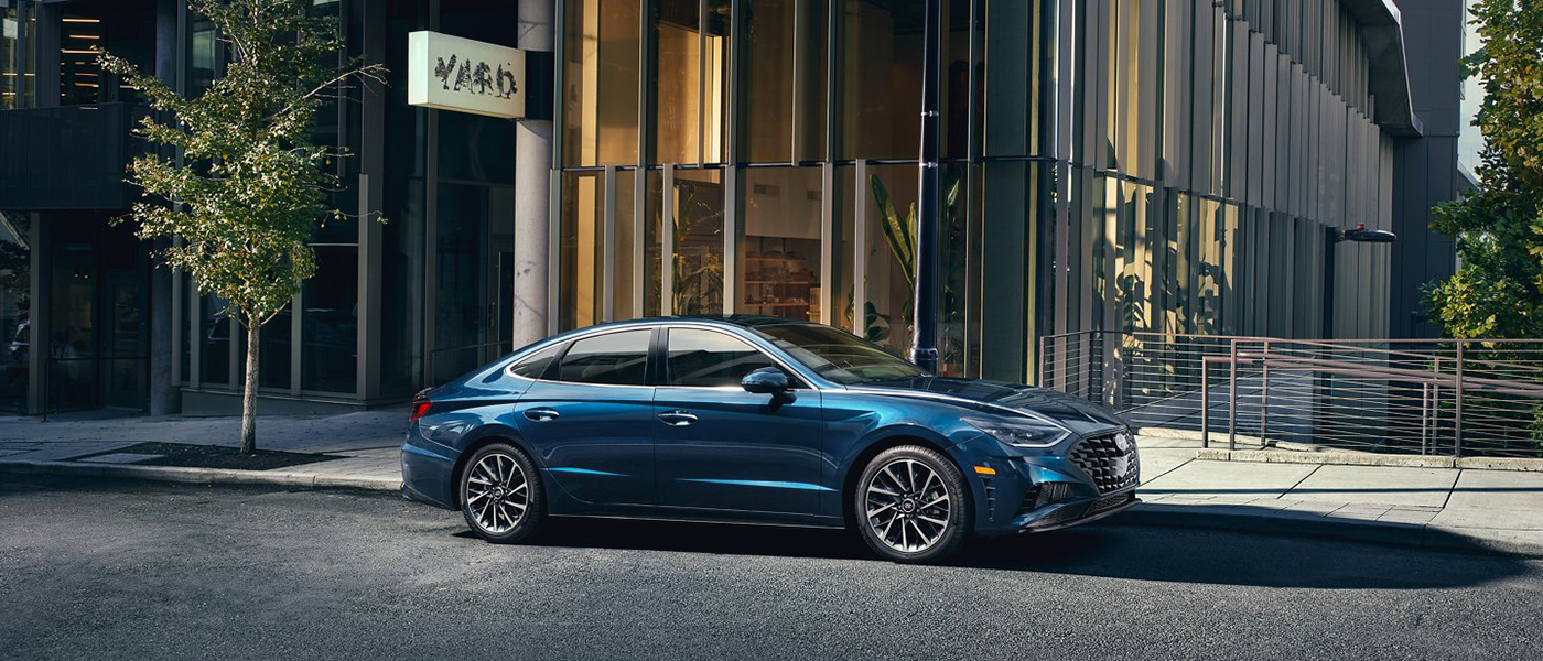 Blue 2021 Hyundai Sonata parked on city streets.