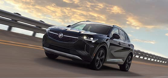 Model Features of the 2021 Buick Envision at Jack Giambalvo Buick-GMC | Envision driving fast on closed track