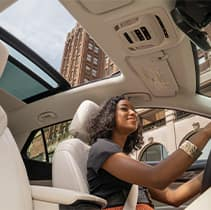 Model Features of the 2021 Buick Envision at Jack Giambalvo Buick-GMC | Happy driver drives with sunroof open