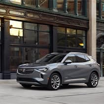 Model Features of the 2021 Buick Envision at Jack Giambalvo Buick-GMC | Envision parked outside in downtown area