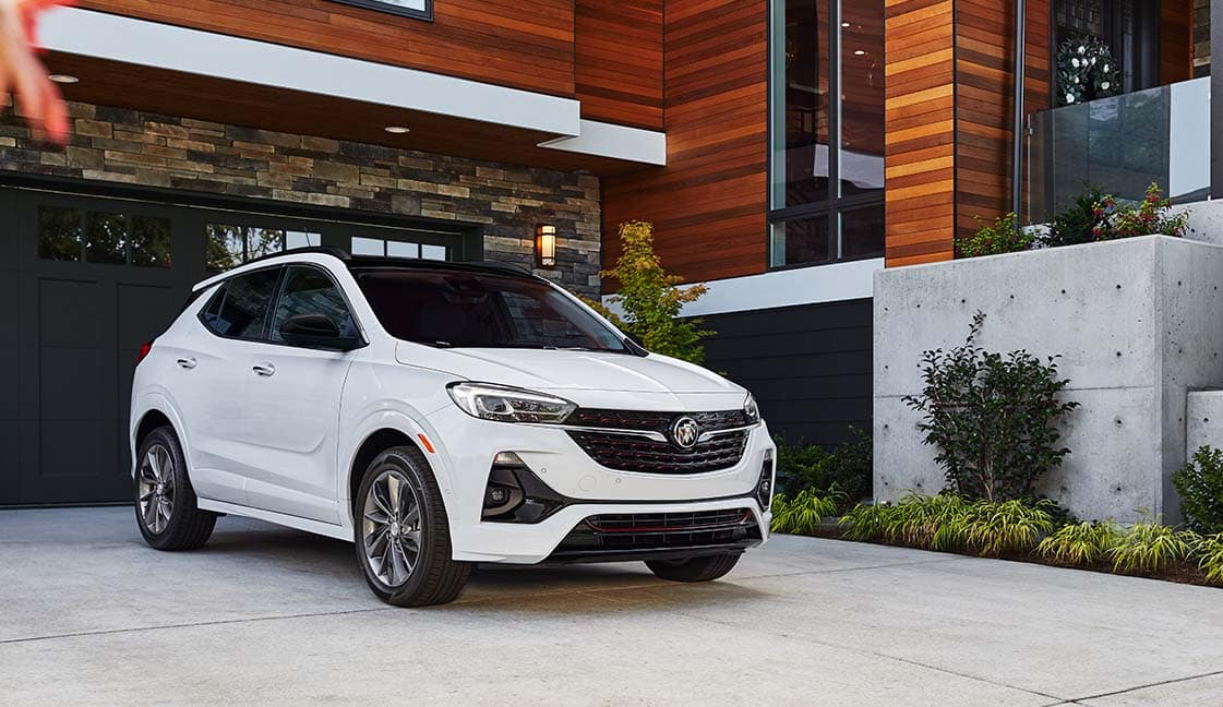 Model Features of the 2022 Buick Encore GX at Jack Giambalvo Buick-GMC | White 2022 Buick Encore GX Parked In Driveway of Modern Contemporary House