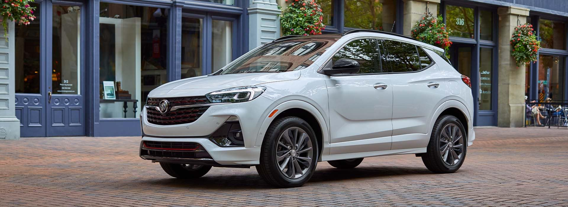 Model Features of the 2022 Buick Encore GX at Jack Giambalvo Buick-GMC | White 2022 Buick Encore GX Street Parked in City