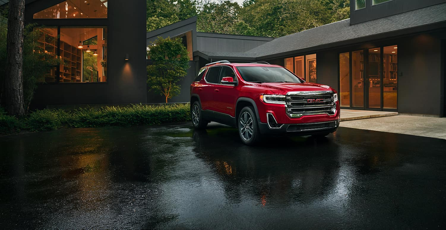 Jack Giambalvo Buick GMC is a Car Dealership in Harrisburg PA | 2022 GMC Acadia parked in driveway