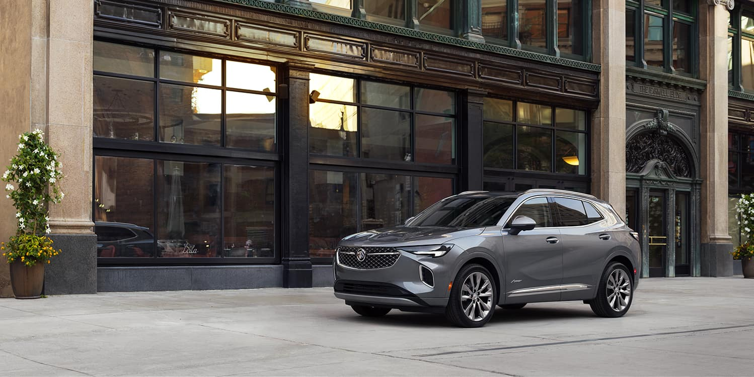 Jack Giambalvo Buick GMC is a Car Dealership in Harrisburg PA | 2022 Buick Envision parked outside of restaurant
