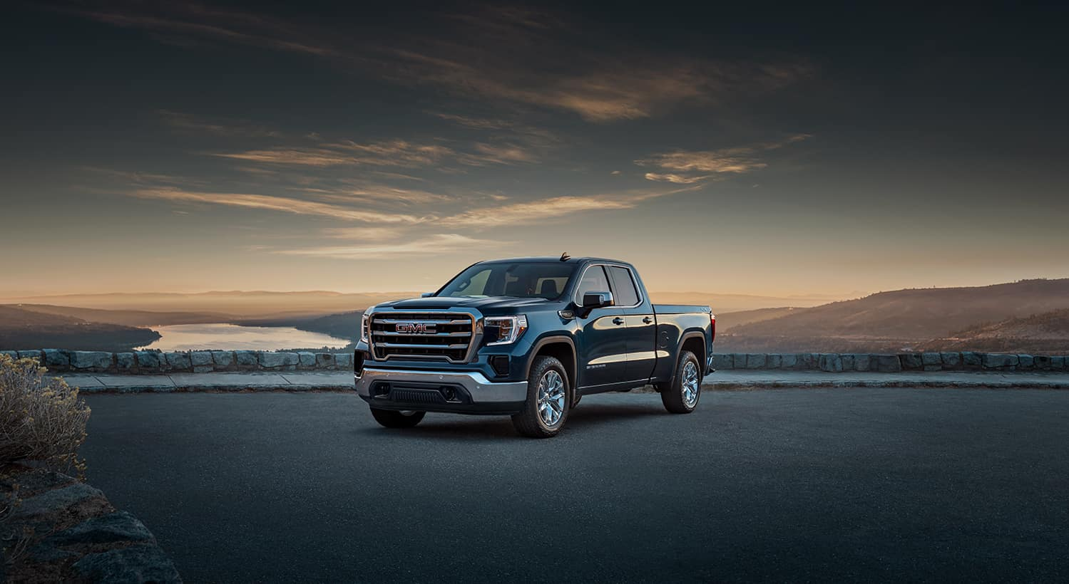 Jack Giambalvo Buick GMC is a Car Dealership in Harrisburg PA | 2022 GMC Sierra 1500 parked overlooking mountains