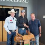 john vance standing beside rodeo champion clint graves