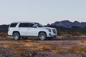 a new cadillac escalade sitting offroad in rural Guthrie, Oklahoma