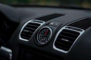 the interior of a new car showing the air conditioning vents
