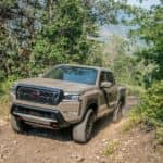 2022 Nissan Frontier Driving Down Dirt Road